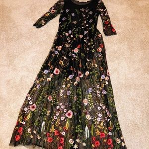 Black tulle maxi dress with floral embroidery
